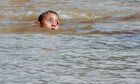 A boy in floodwaters in Sao Paulo, Brazil
