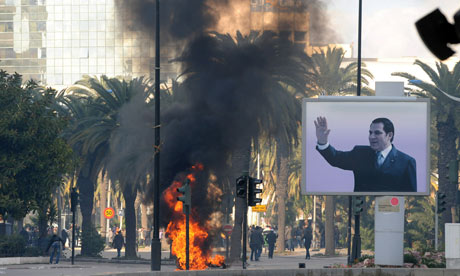 Smoke rises from fire left after clashes between security forces and demonstrators in Tunis