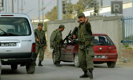 Tunisian soldiers check cars in Tunis