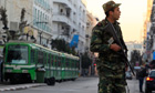 A Tunisian army soldier patrols downtown in Tunis