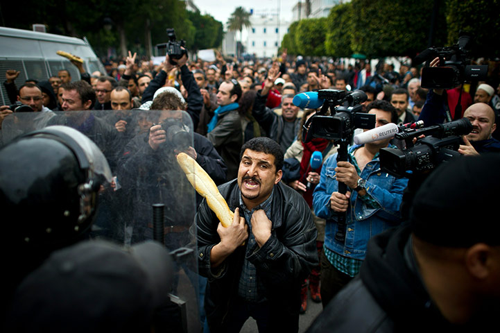 A-Tunisian-protester-hold-018.jpg