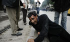 A man lies injuried during a demonstration in Tunis