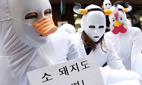 Animal right activists at a memorial in South Korea for animals slaughtered due to foot-and-mouth