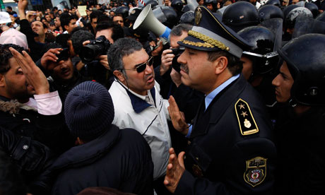 Protesters confront police during a demonstration in downtown Tunis, Tunisia