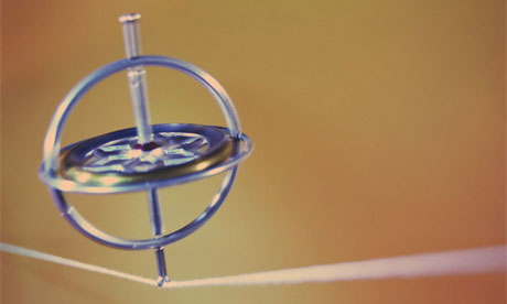 Gyroscope balancing on string