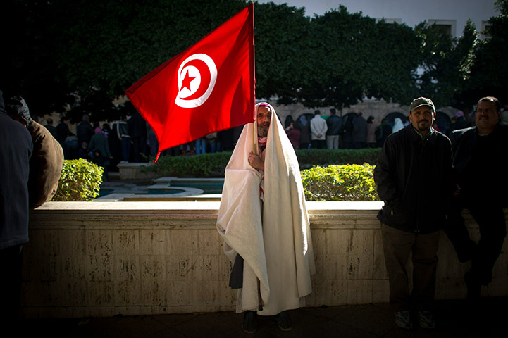 Tunis-Tunisia-A-man-holds-025.jpg