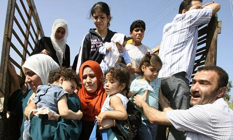 Palestinian refugees fleeing their besieged camp in north Lebanon in May 2007