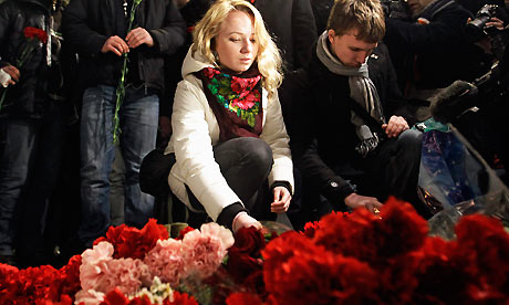 People lay flowers at the scene of the Domodedovo airport explosion