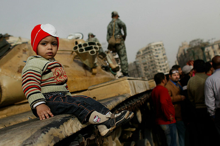 Egyptian Armed Forces Photos and Videos A-child-sits-on-a-tank-wh-005