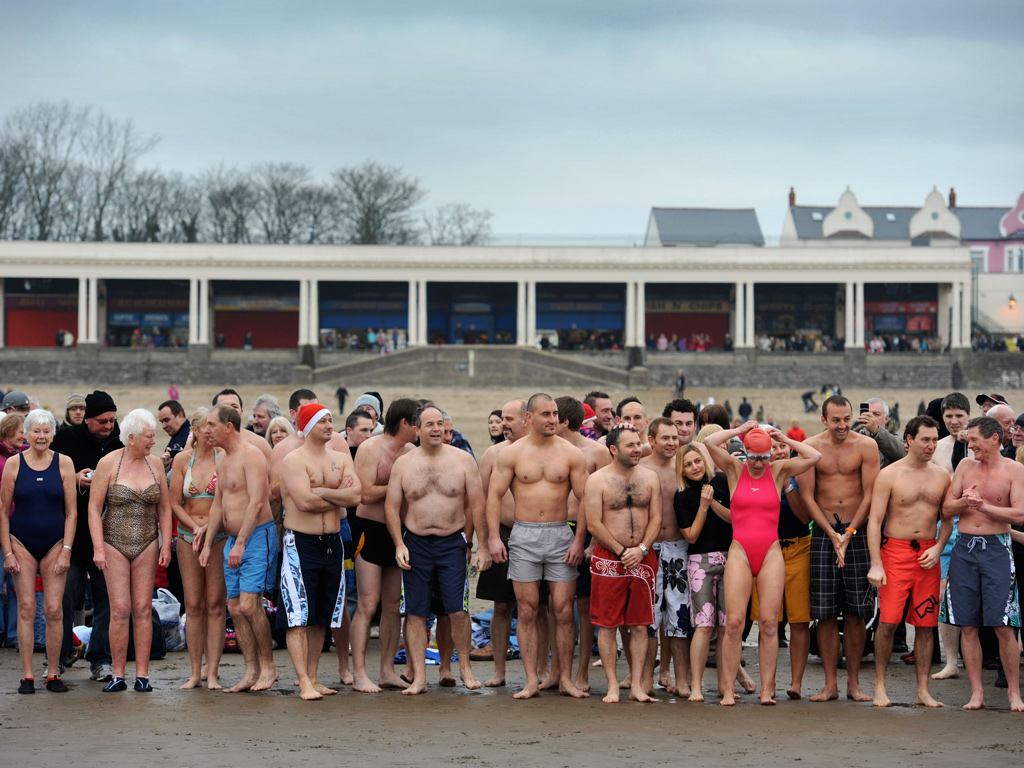 Participants line up to prepare for the annual New Year's Day swim at Barry Island, South Wales