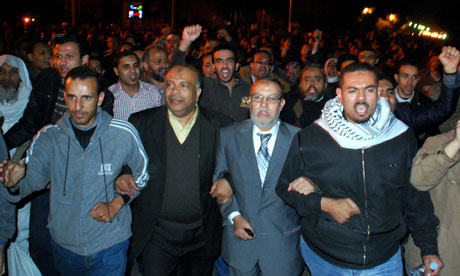 Muslim Brotherhood seniors Essam el-Erian and Saad el-Katatni ake part in a protest in Cairo, Egypt.