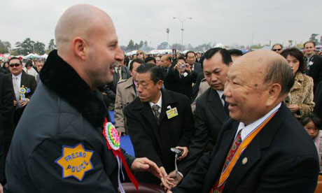 Vang Pao, right, is welcomed at a new year celebration for America's Hmong community.