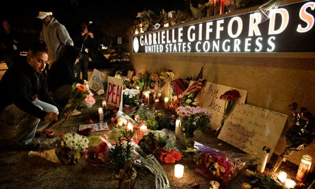 Mourners leave flowers during a candlelight vigil in Tucson for Gabrielle Giffords