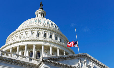 US Capitol building with flag at half-mast