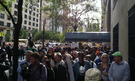 Occupy Wall Street protesters outside the New York home of banker Howard Milstein