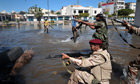 Libyan goverenment forces fire on troops loyal to Muammar Gaddafi