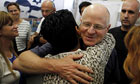 Gilad Shalit's father, Noam, hugs a supporter in Jerusalem