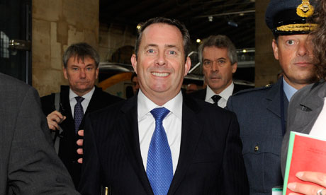 Liam Fox arrives at the Paris Gare du Nord station
