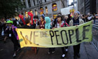 Members of Occupy Wall Street celebrate after learning they can stay in Zuccotti Park in New York