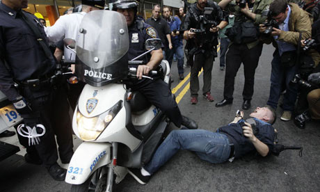 A police officer on a scooter runs over a legal observer at an Occupy Wall Street demonstration