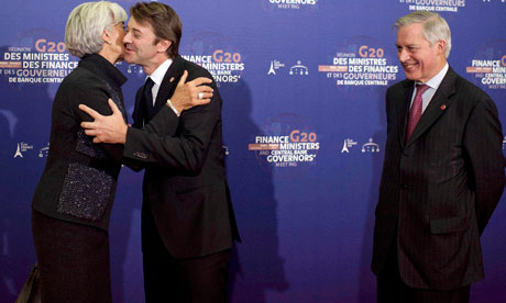 IMF chief Lagarde embraces France's Finance Minister Baroin