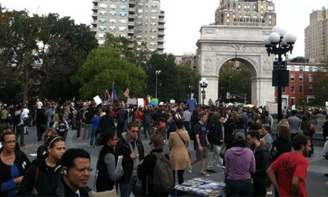 Occupy Wall Street protesters listen to speeches in Washington Square