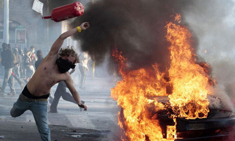 A protestor hurls a canister during clashes in Rome