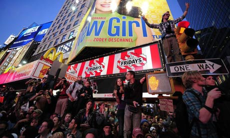 Occupy Wall Street participants stage a protest on Times Square in New York. A