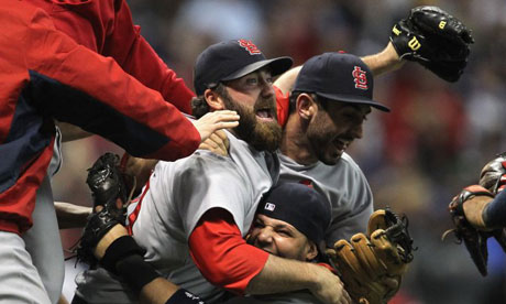 Jason Motte, Daniel Descalso and Yadier Molina of the St Louis Cardinals celebrate
