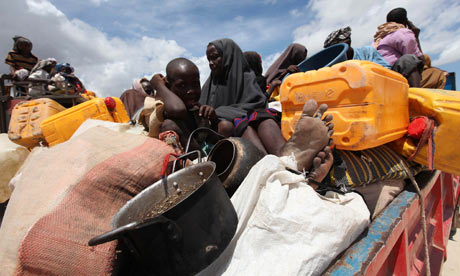 Displaced families wait to board trucks from Ala-yasir camp, Somalia
