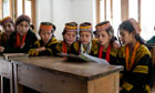 Kalash girls attend school in their mountain valley home deep in the Hindu Kush