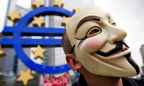 Guy Fawkes masks have become the global face of the Occupy protests. Photograph: Frank Rumpenhorst/EPA