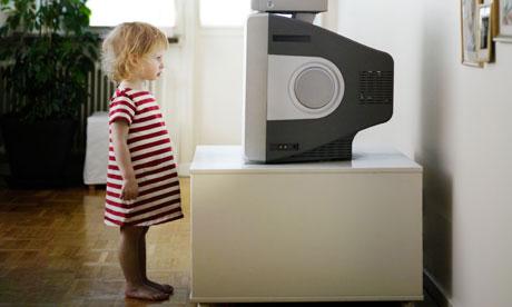 A little girl watching TV Sweden