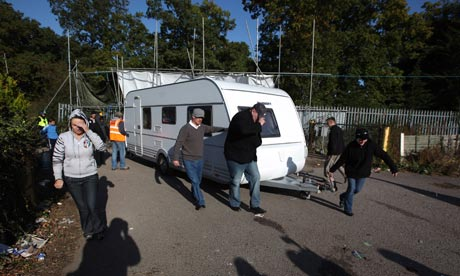 Activists move a caravan to a safer spot during evictions from Dale Farm travellers camp