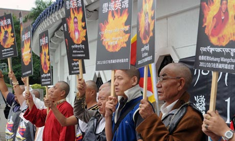 Tibetans display portraits of people who killed themselves in self-immolation