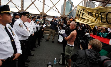 Police square off against protesters on Brooklyn bridge during the Occupy Wall Street march. Photograph: Jessica Rinaldi/Reuters