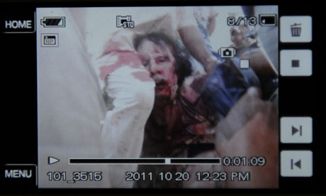 An image purportedly showing Muammar Gaddafi's capture in Sirte, Libya on 20 October 2011