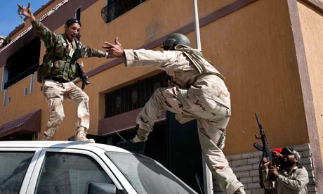 Libyan soldiers celebrate the death of Muammar Gaddafi