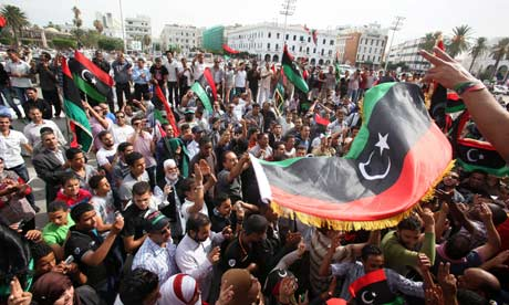 Libyans celebrate the fall of Sirte and the death of Muammar Gaddafi