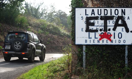 Graffiti on a sign welcoming visitors to the Spanish Basque village of Llodio