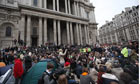 Occupy protesters gather for a meeting in front of St Paul's Cathedral in London