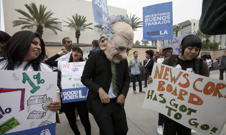 A protestor dressed as Rupert Murdoch outside the News Corp annual meeting