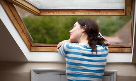 Woman looking out of a skylight