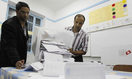 Tunisian election officials count votes at a polling station
