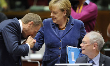 Polish prime minister Donald Tusk kisses the hand of German chancellor Angela Merkel at EU summit