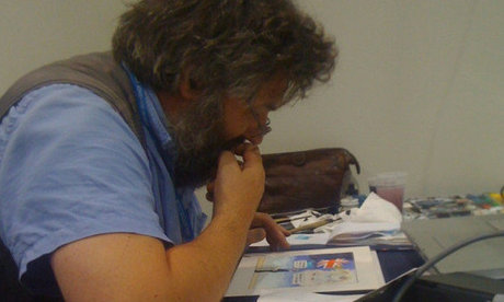 Steve Bell working on a cartoon