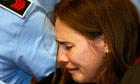 Amanda Knox breaks down as she is helped away after hearing