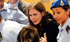 Amanda Knox cries following the verdict that overturns her conviction