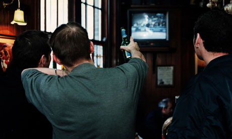 Men watching a football match in a pub (Photo: Guardian/David Sillitoe)