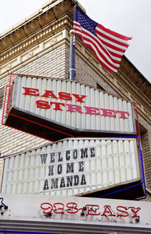 Sign welcoming home Amanda Knox at the Easy Street record store in the Seattle